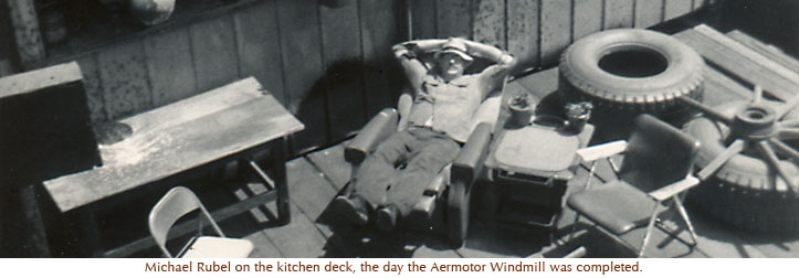 Michael Rubel on the kitchen deck, the day the Aermotor Windmill was completed. 1971.